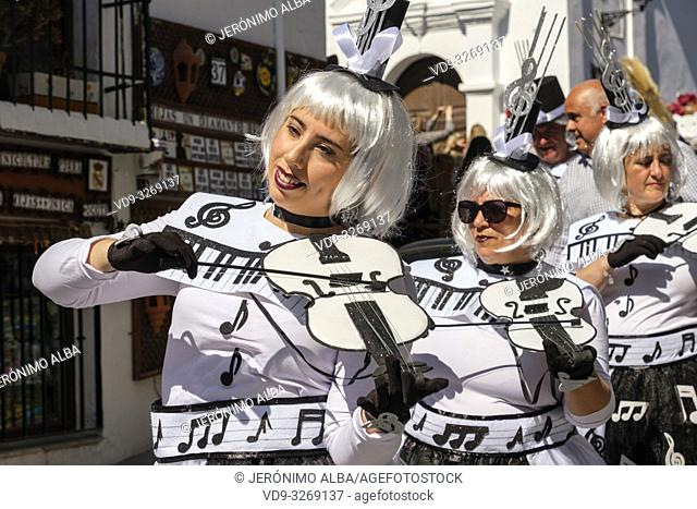 Traditional carnival parade at the white village of Mijas. Malaga province Costa del Sol. Andalusia, Southern Spain Europe