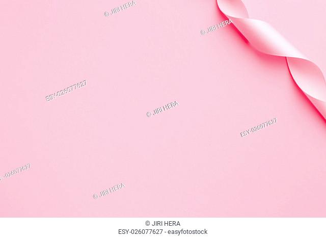 the pink ribbon curls on a pink background