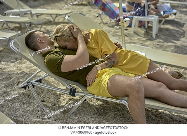 Happy young couple on the beach, Russian ethnicity, Hersonissos, Crete, Greece
