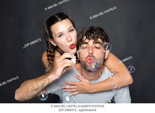 Mid-adult couple blowing bubbles