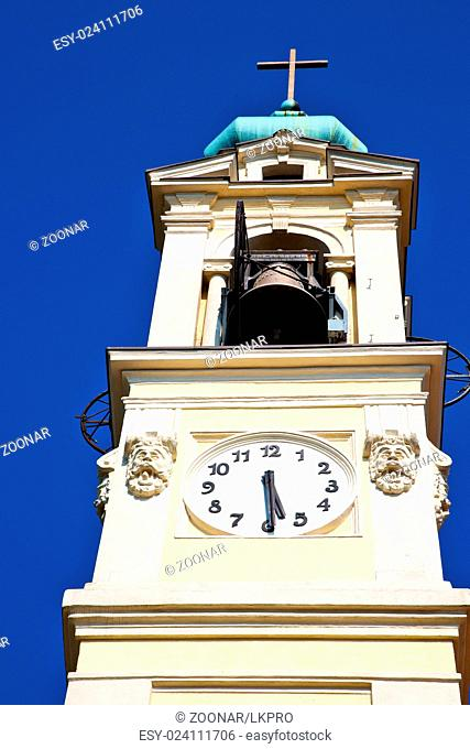 ancien clock tower in  old stone and bell