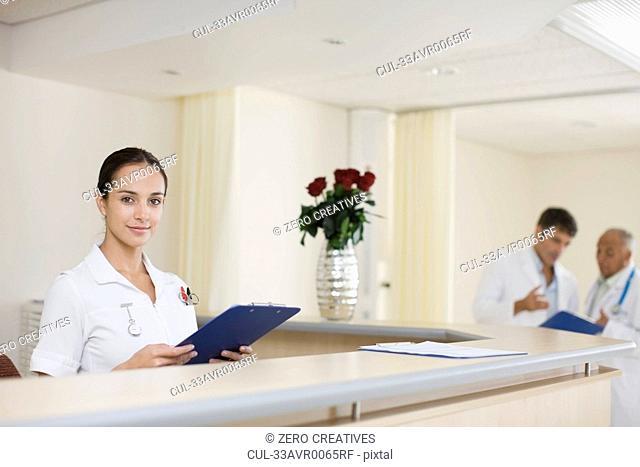 Nurse working at hospital reception