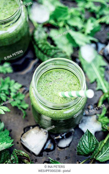 Two glasses of wild herb smoothie with apple, banana and lime juice