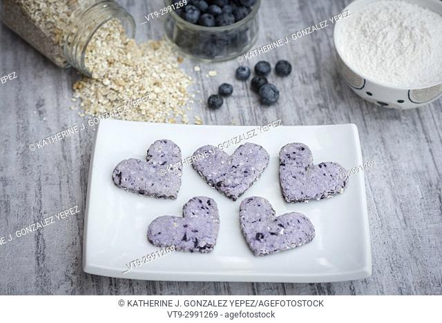 Heart sheaped blueberry cookies on a white plate