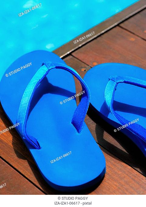 Close-up of slippers at the poolside