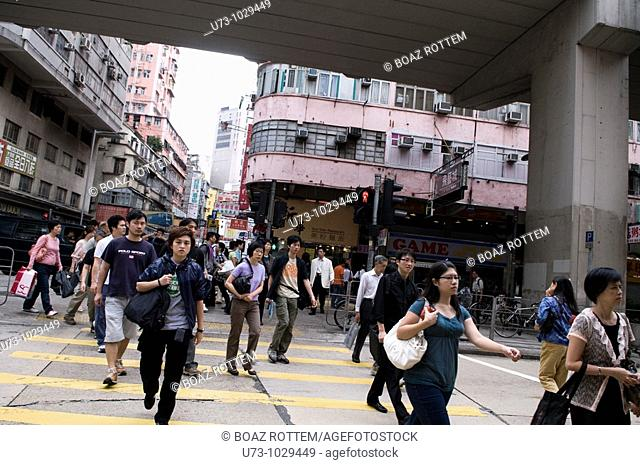 A busy pedestrian crossing during lunch time, Kowloon, Hong Kong