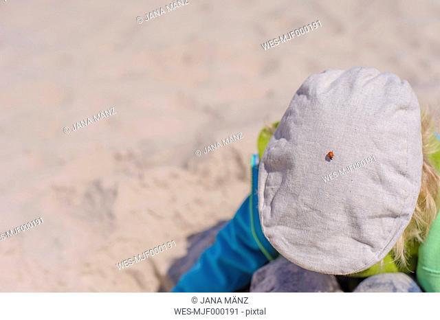 Germany, Mecklenburg Western Pomerania, Boy playing on beach at baltic sea