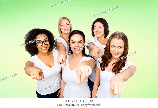 choice, friendship, body positive, gesture and people concept - group of happy different size women in white t-shirts pointing finger on you over green natural...
