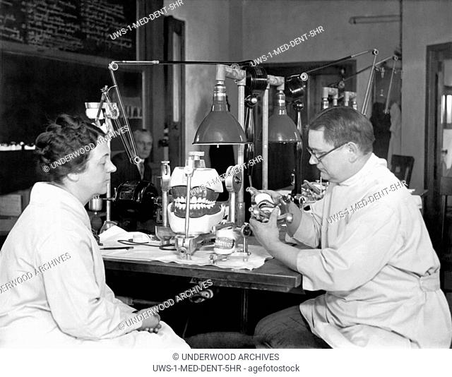 Chicago, Illinois: March 21, 1928.Dr. Rudolph Schlosser at the Northwestern University Dental Laboratory explains the proper use of the Articulator which shows...