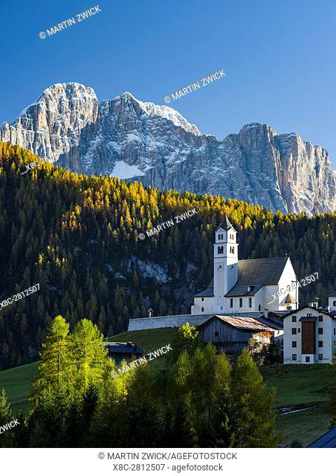 Village Colle San Lucia in Val Fiorentina. La Civetta in the background, an icon of the Dolomites. The Dolomites of the Veneto are part of the UNESCO world...