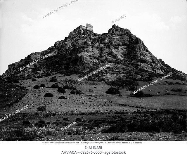 View of the Silìqua lava hill, Sardinia. The remains of the Acquafredda Castle are visible at the peak, shot 1920 - 1930 ca. by Alinari, Fratelli