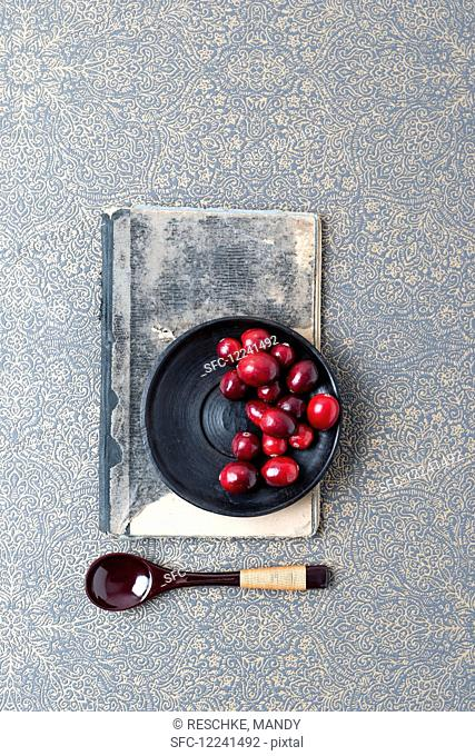 Cranberries on a black plate