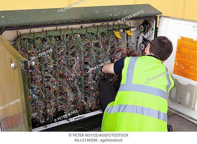 Engineer working on BT street telephone wiring box