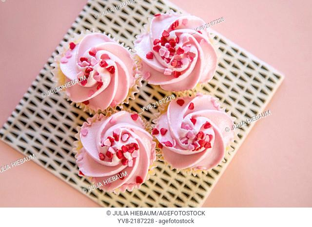 Four pink cupcakes