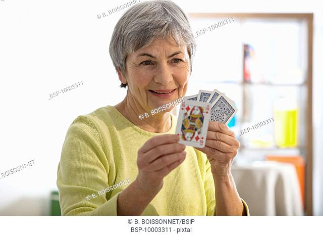ELDERLY P. PLAYING A GAME