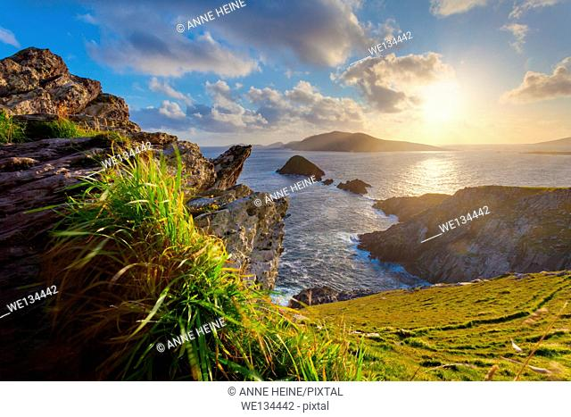 scenic irish west coast, looking from dingle peninsula (Europe`s most westerly mainland point)in western ireland towards blasket islands while the sky is...