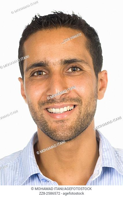 Happy ethnic man smiling against a white background