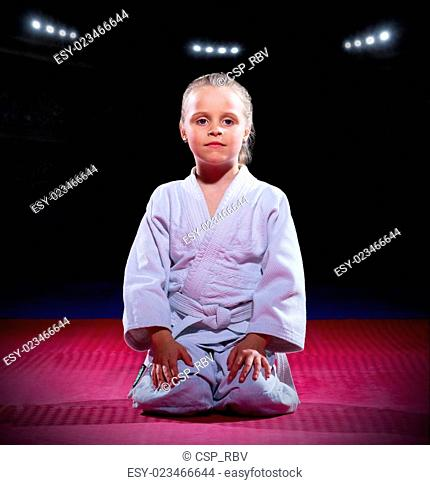 Girl aikido fighter at sports hall