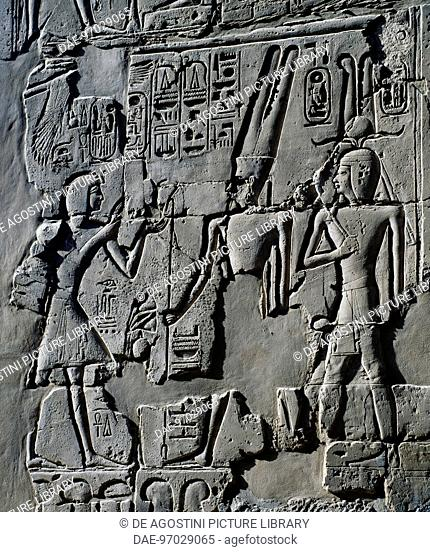 A young Ramesses II before the God Amun, detail from scenes of offerings to the gods, relief, interior walls of the Great Hypostyle Hall