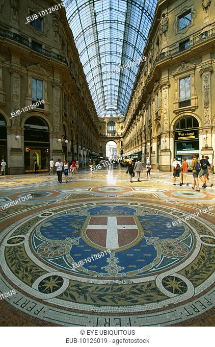 Galleria Vittorio Emanuele II shopping arcade interior with arched glass roof and mosaic floor lined with designer shops