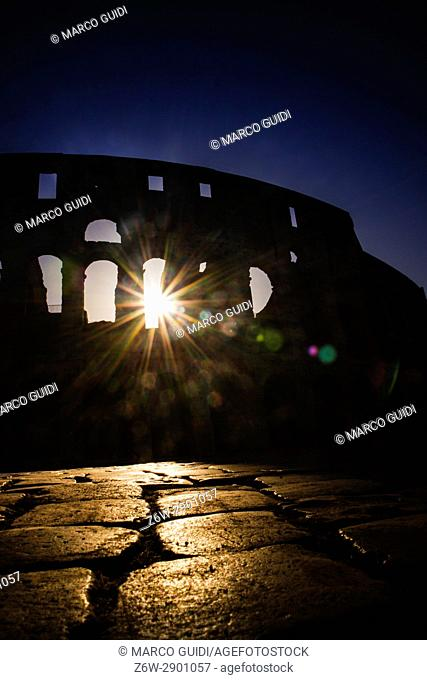 The monument of the Colosseum in Rome Italia taken back in against light to the dawn