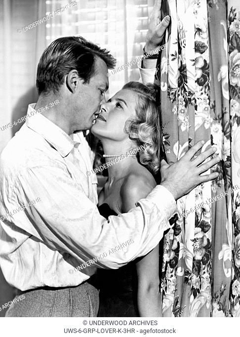 Hollywood, California: 1954.Marjie Millar and Alex Nicol in a scene from the film, About Mrs. Leslie