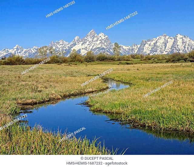 United States, Wyoming, Grand Teton National Park, stream with the Teton Range and Grand Teton (4,199 m/13,775 ft), highest point of the park, in the background