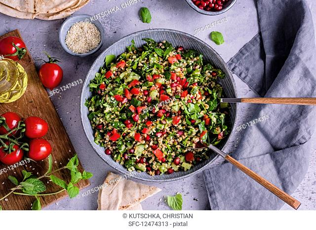 Tabbouleh with pomegranate seeds and sesame seeds (Arabia)
