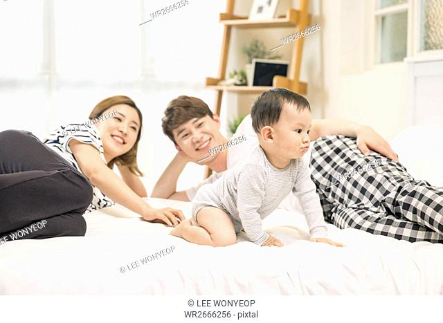 Harmonious family with baby son resting