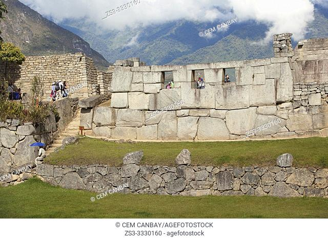 Tourists in front of the Three Windows at Machu Picchu, Unesco World Heritage Site near Cusco, Urubamba Valley, Peru, South America