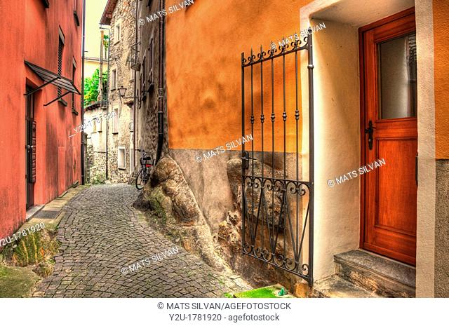 Old colorful rustic alley with stone road