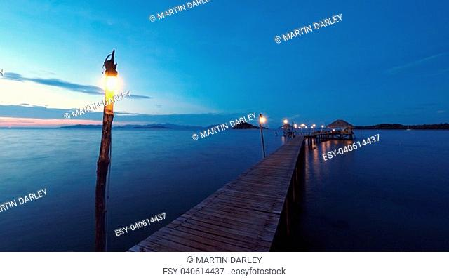 A dusk shot of a rustic pier, jutting out into the Gulf of Thailand. Koh Mak, Ko Kut District, Trat, Thailand