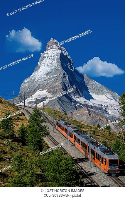 Gornergratbahn passenger train under Matterhorn, Zermatt, Canton Wallis, Switzerland