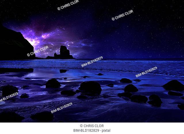 Night sky over rocky Carbost coastline, Isle of Skye, Scotland