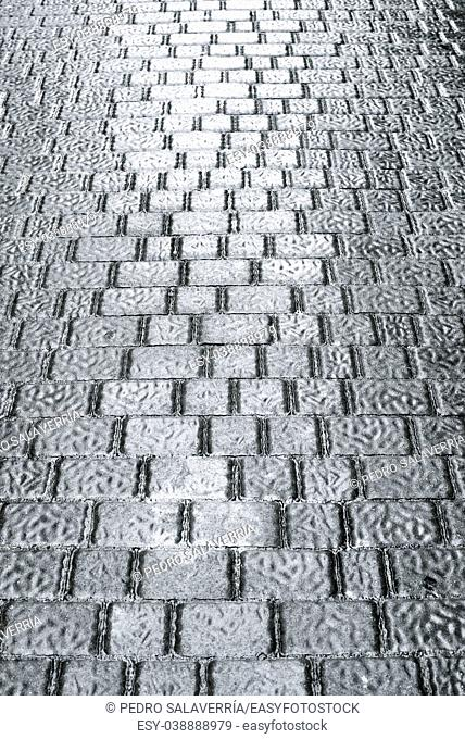 floor of a street with stone tiles in Salamanca district, Madrid, Spain