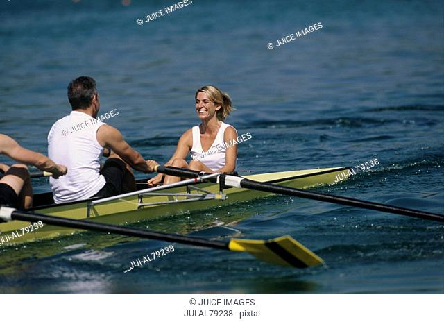 Woman on boat with rowers