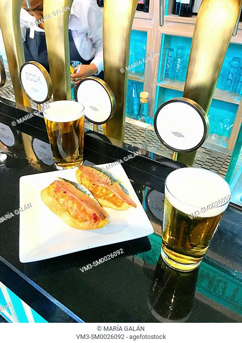 Two glasses of beer and tapas in a bar. Madrid, Spain