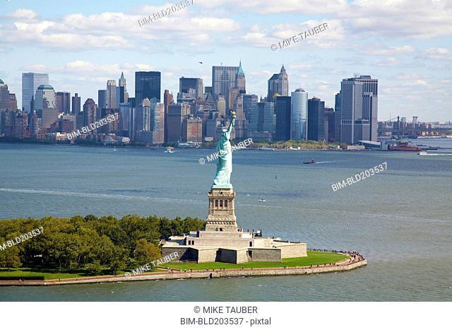 Statue of Liberty and city skyline, New York, New York, United States