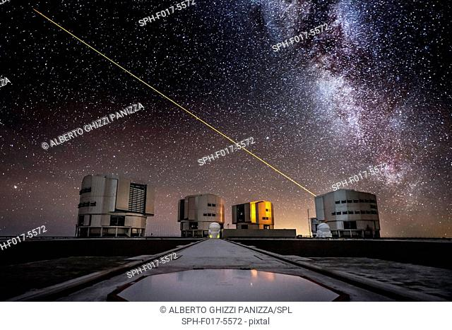Laser beam from the UT4 telescope in the sky above the Paranal ESO observatory in Chile with the milky way in the background