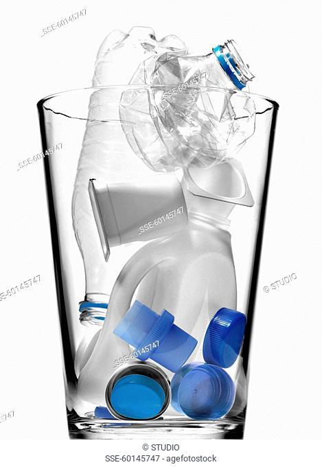 Trash can full of empty plastic bottles