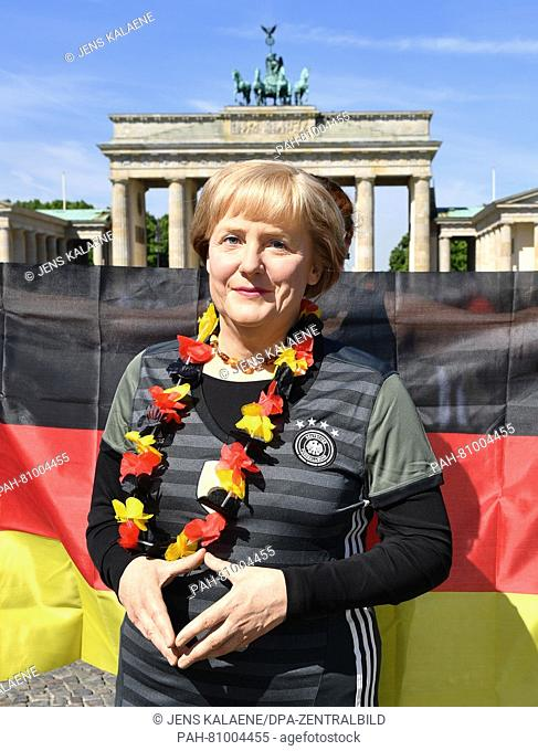 The wax figure from Madame Tussauds of Chancellor Angela Merkel wearing a soccer outfit can be seen during a press meeting on the European Championships in...