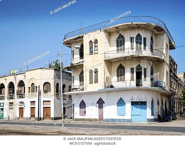 local red sea style architecture street in central massawa old town eritrea