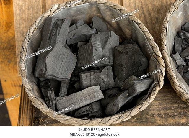 Charcoal in baskets, last charcoal burning in Switzerland, Romoos, Biosphere Reserve Entlebuch, Canton of Lucerne, Switzerland