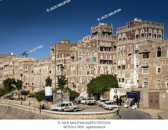 street scene and local heritage architecture buildings in old town of sanaa yemen