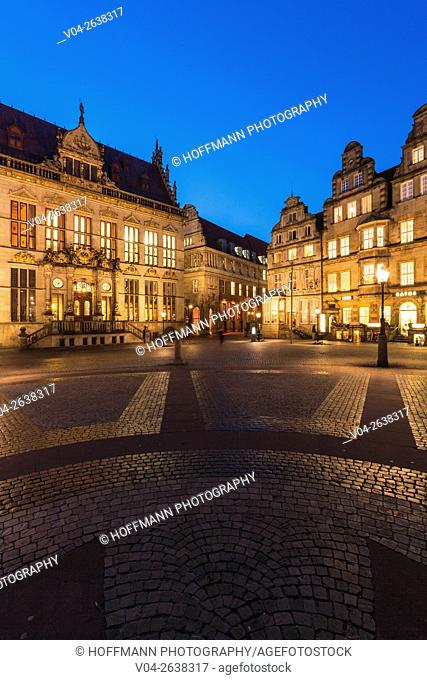 Illuminated House Schuetting and historic houses in the evening, Bremen, Germany, Europe
