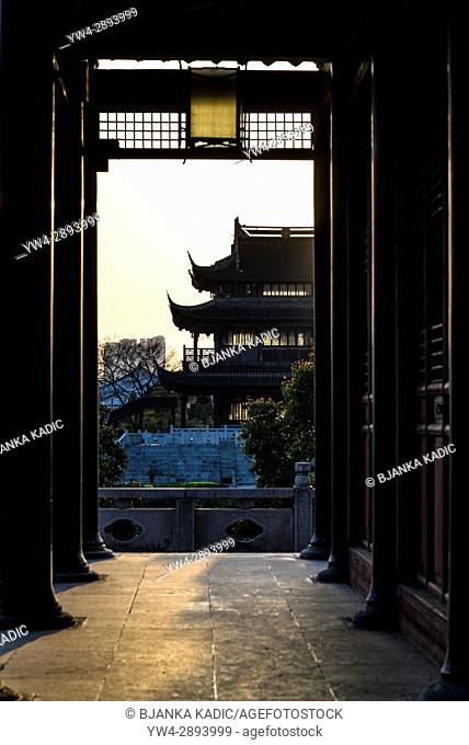 Pavilion with flying eaves seen through the frame of another building, Pan Gate or Panmen Scenic Area, Suzhou, Jiangsu Province, China