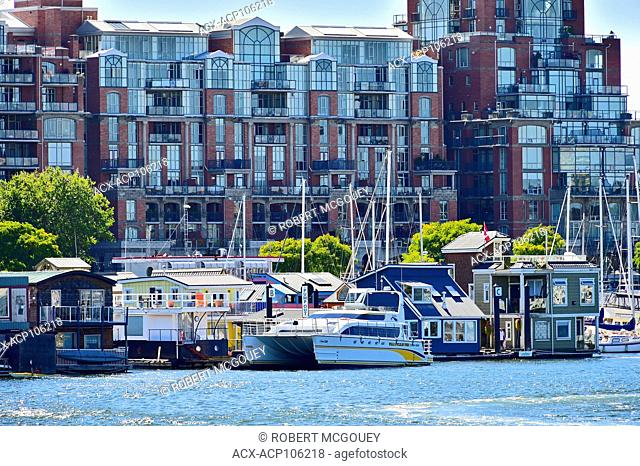 Floathouses and condos crowd the inner harbour at the waterfront in Victoria, British Columbia, Canada