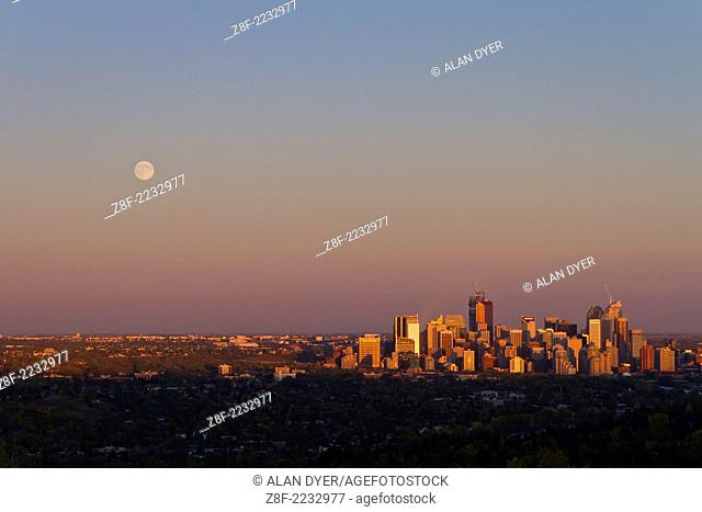 Full Moon rising over Calgary skyline as shot from the CFCN Coach Hill location overlooking the city to the east. Moon came up about 6:55 pm and sunset was...