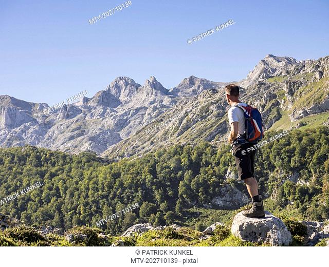 Man on hiking tour in Picos de Europa near Covadonga, Asturias, Northern Spain
