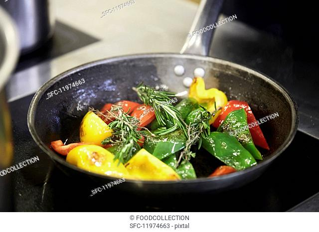 Vegetables being fried in a pan